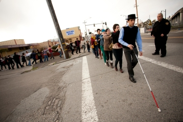 Carmen - 3. Blind Field Shuttle - Photo by Jordan Reznick (crossing the street with security guard) color